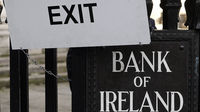 Exit sign outside the Bank of Ireland as the Irish government comes under pressure to accept financial help from Europe