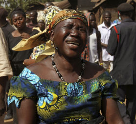 Woman mourning in Jos, Nigeria (credit:Reuters)