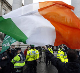 A protestor following clashes with police officers after breaking through the gates of Government Buildings in Dublin, after details of the bailout for Ireland are revealed (credit:Reuters)
