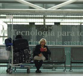 A passenger reads as she waits at Lisbon airport