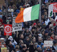 Protester in Ireland. Up to 50,000 people took to the streets of Dublin to protest agains planned austerity cuts (credit:Reuters)