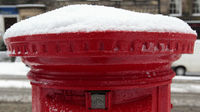 Snow on a postbox. Temperatures reached a record low in Wales overnight (credit:Reuters)