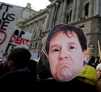 A protester wears a Nick Clegg mask during a tuition fees demo (Reuters)