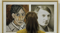A woman looks at a self-portrait by Picasso as a row brews over ownership of some of his works (Reuters)