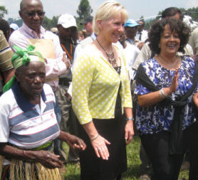 UN representative Margot Wallstrom dancing with the villagers