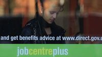 A woman enters a job centre employment centre in Leicester, as the Government announces savings of �18bn in the benefits bill (Reuters)