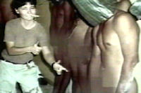 Abu Ghraib: videograb from Al-Arabiya television channel rebroadcasting from US news program 60 minutes showing a US soldier pointing at nude hooded Iraqi prisoners. (Getty)