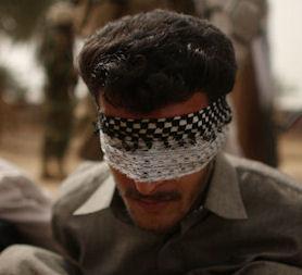 Iraq war files: a man blindfolded during a raid. (Getty)