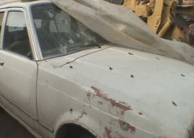 Iraq war files: civilian car with bullet holes.