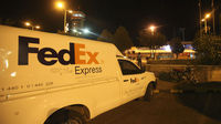 A FedEx van is seen at Yemen's Sana'a International Airport where two airplanes with explosives hidden in their cargo left enroute to the US (credit:Reuters)