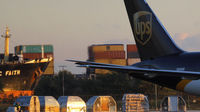 A UPS plane grounded in Philadelphia after explosives were found onboard cargo planes in Dubai and at East Midland's airport (credit:Reuters)