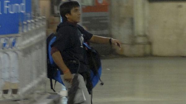 Gunman Mohammad Ajmal Kasab walks in the premises of the Chhatrapati Shivaji Terminus in Mumbai. (Reuters)