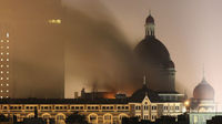 Smoke rises from the Taj Hotel in Mumbai, November 2008. Gunmen killed at least 80 people in a series of attacks. (Reuters)
