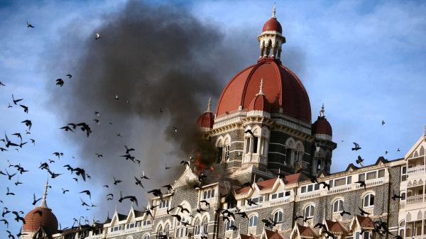 Pigeons fly near the burning Taj Mahal hotel following the 2008 Mumbai attacks. (Reuters)