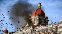 Pigeons fly near the burning Taj Mahal hotel following the 2008 Mumbai attacks. (Reuters)