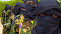 Members of the hard line al Shabaab Islamist rebel group parade during a military training exercise. (Reuters)