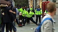 Ian Tomlinson is hit by a police officer at the London G20 demonstrations