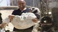 Man carries injured person in Lebanon