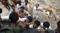 The army evacuates people from Muzaffar Ghar. (Reuters)