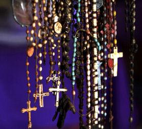 The crucifix symbolises the Catholic faith