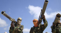 Members of al Shabaab Islamist rebel group hold their weapons in Somalia's capital Mogadishu (Reuters)