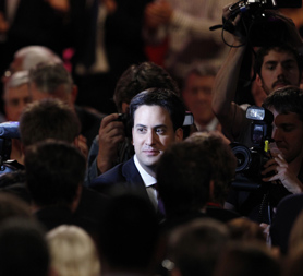 Labour leader Ed Miliband leaves the conference hall after his debut speech.