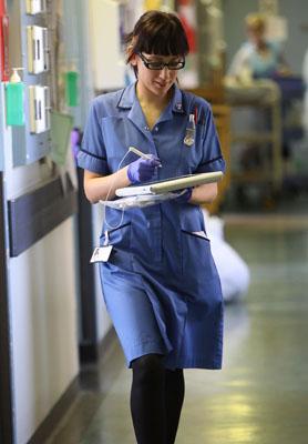 NHs reform: a nurse walks down a hospital corridor in Birmingham. (Getty)