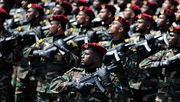 Sri Lankan army commandos march in a military parade during the victory day parade in Colombo on June 18, 2010