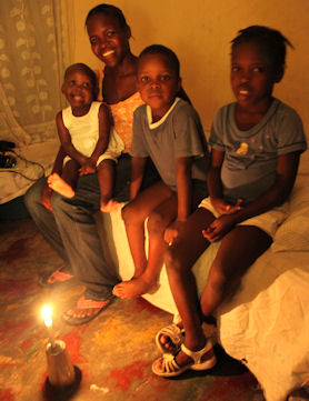 Landina's mother at home in Haiti with her other children