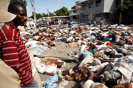bodies pile up in haiti as aid effort pledged channel 4 news