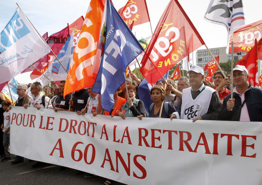 Public sector workers in Paris protest changes to pension laws