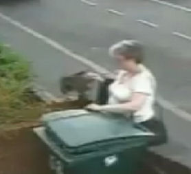CCTV of a woman accused of putting a cat into a wheelie bin